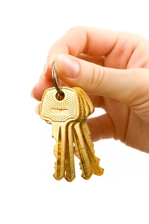 Hand with keys isolated on white photo