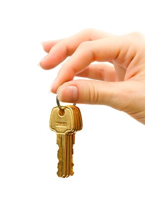 Hand with keys isolated on white Stock Photo - 8775034