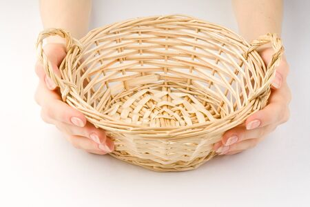 spliced: Hands and basket isolated on white