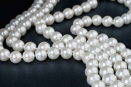 pearl jewelry: Pearl isolated on black Фото со стока