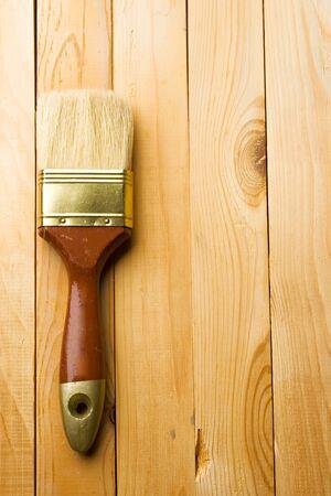 Brush isolated on wooden background photo