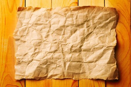 Paper sheet isolated on wooden background Stock Photo - 8974057
