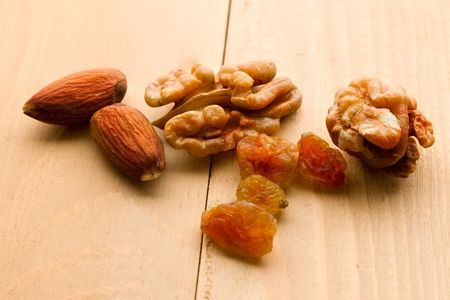 Nuts and raisins isolated on wooden background photo