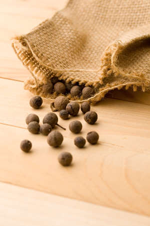 Pepper isolated on wooden background photo