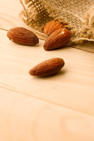 Almonds isolated on wooden background photo