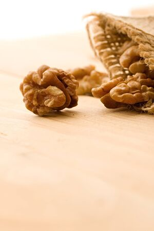 Walnut isolated on wooden background Stock Photo - 8986626