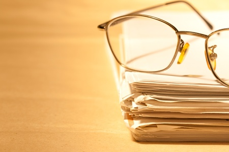 Stack of papers and glasses Stock Photo - 8973866