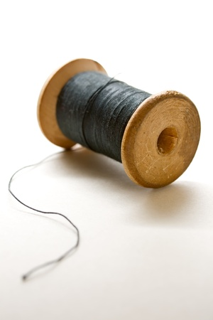 Thread bobbin on white background  photo