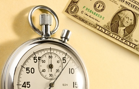 Stopwatch and dollar isolated on yellow background photo
