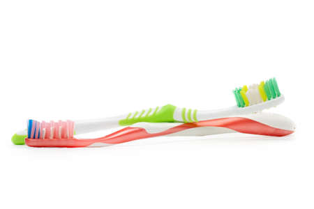 Toothbrushes on the white background photo