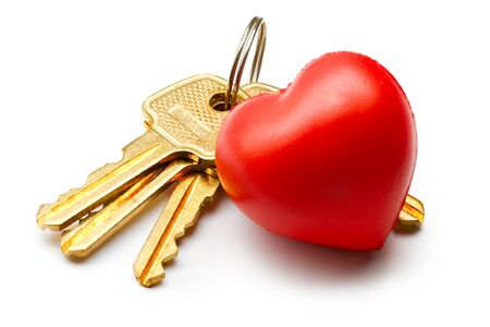 Bunch of keys and heart on the white background photo