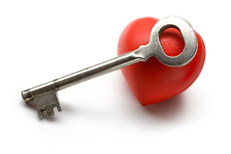 Key and heart on the white background Stock Photo