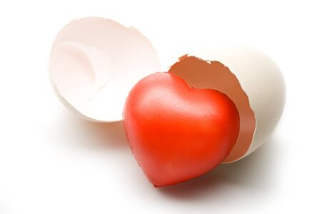 Eggshel and heart on the white background photo
