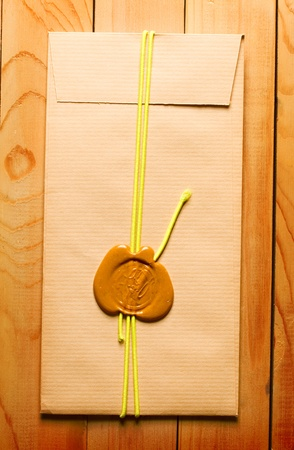 missive: Envelope with sealing wax on the wooden background