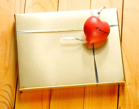 Gift on the wooden background photo