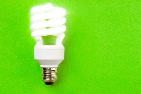 Energy saving bulb on the green background Stock Photo - 9623146