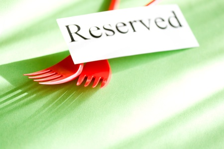 Forks and card on green background Stock Photo - 9622800