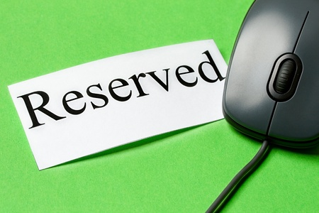 reserved: Computer mouse and card isolated on the green background