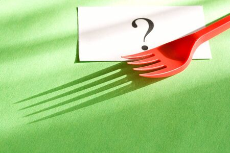 Fork and card isolated on green background Stock Photo - 9623124