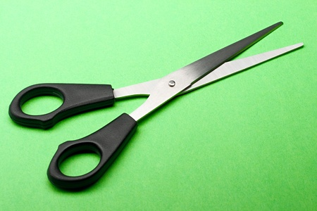 Scissors isolated on green background photo