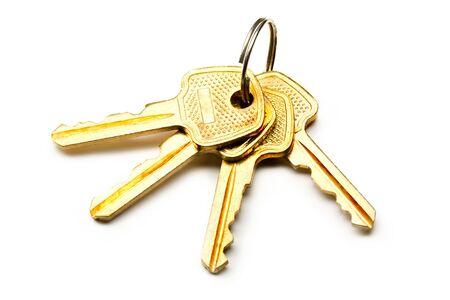 Bunch of keys on white background photo