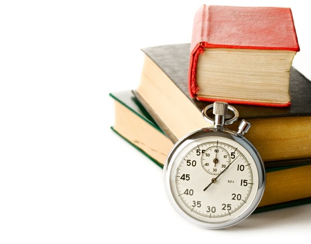 Stopwatch and books on the white background Stock Photo