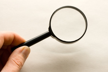 Magnifying glass in hand photo