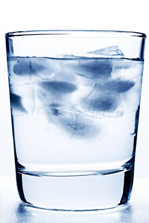 Glass of cool water with ice photo