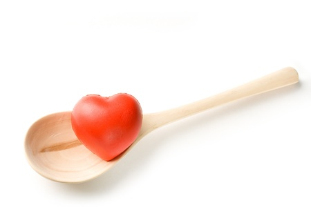 Spoon and heart on white background Stock Photo - 10014717