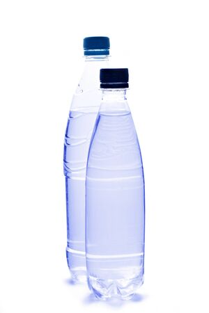 Plastic bottles of water on white background photo