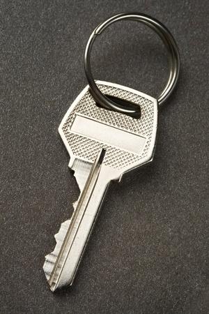 Key isolated on the dark background Stock Photo - 10431135