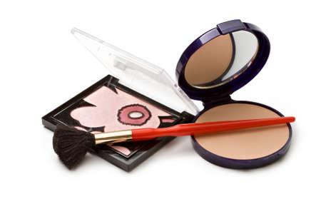 Make-up powder in box and make up brush isolated on white  photo