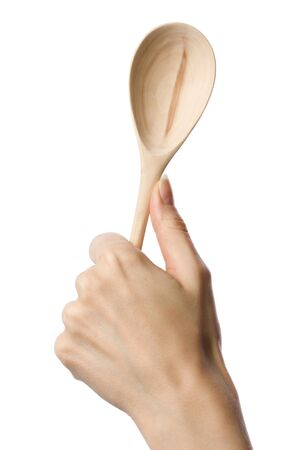 Woman holding wooden spoon in the hand  Stock Photo - 10831244