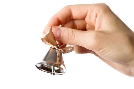 Woman holding bell in the hand photo