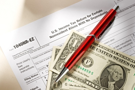 Tax form and pen and dollars Stock Photo - 10831401