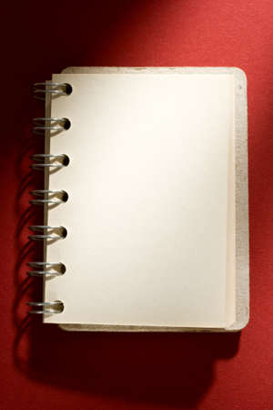 Notepad isolated on red background Stock Photo - 10831420