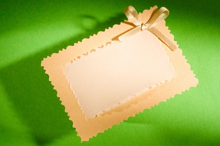Greeting card isolated on the green background photo