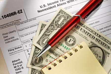refund: Tax form, pen, notepad and dollars Stock Photo