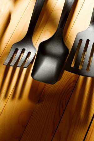 Kitchen utensil collection isolated on wooden background Stock Photo - 10831406