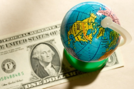 american currency: Globe and one dollar