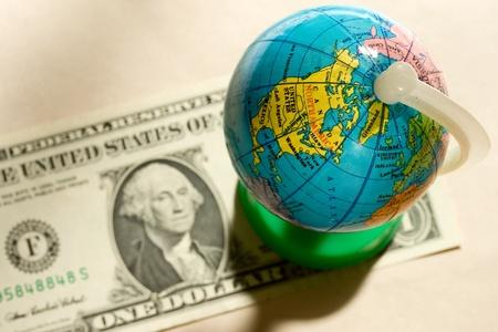 Globe and one dollar Stock Photo - 10831297