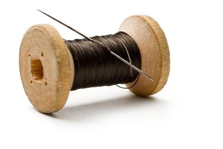 needle and thread: Thread bobbin isolated on white background  Stock Photo