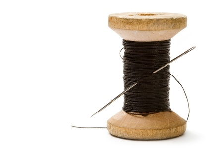 Thread bobbin isolated on white background  photo