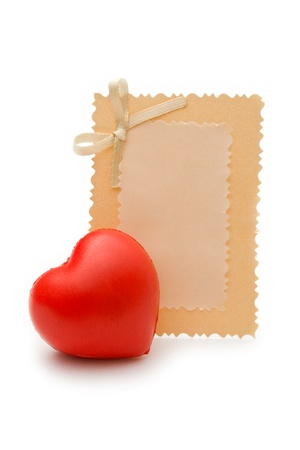 Greeting card and heart on the white background photo