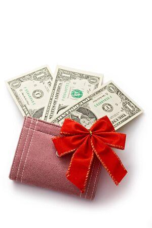 Dollar with holidays bow isolated on white  photo