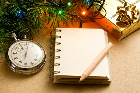 christmas list: Christmas tree, stopwatch, gift and notepad Stock Photo