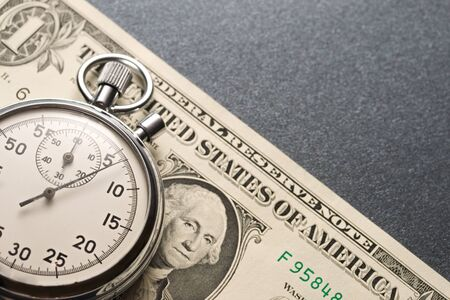 Stopwatch and dollars Stock Photo - 11144374