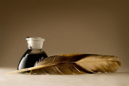 A feather with the bottle full of ink photo