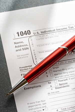 Tax form and a red pen photo