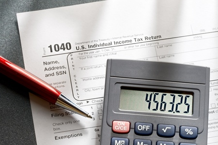 Tax form, red pen and calculator Stock Photo - 11293128